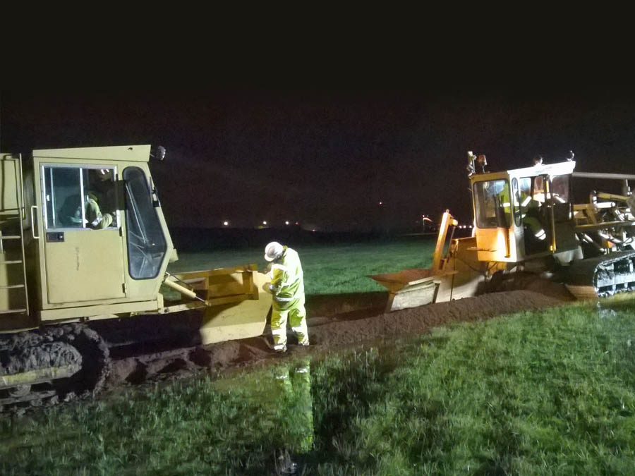 Night work drainage beside the runaway for an International Airport